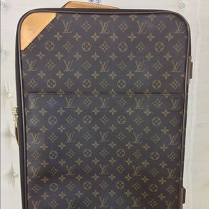 Louie Vuitton carry on luggage